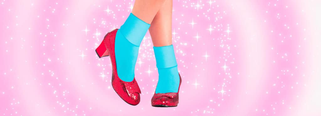 glittery red shoes on a glittery pink background